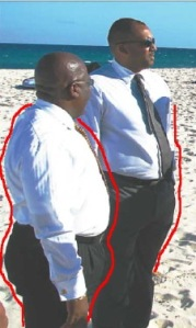 Barbado Environment Denis Lowe (left) remains silent on the Mullins Beach fiasco since his election.