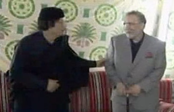Gaddafi celebrates with terrorist on national television.