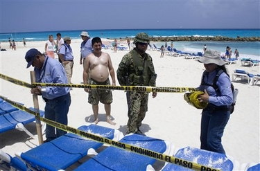 Armed Mexican troops seize hotel beach created with stolen sand and illegally-built groin (rocks in background).