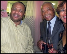 Leroy Parris and good friend Finance Minister Chris Sinckler share champagne