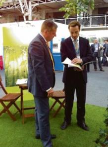 Kate's brother – James Middleton, right, at the carbon trade exhibition in London October 2010
