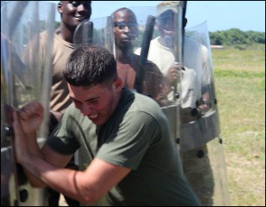 U.S. Marine trains Barbados Defence Force in crowd control, June 2012.